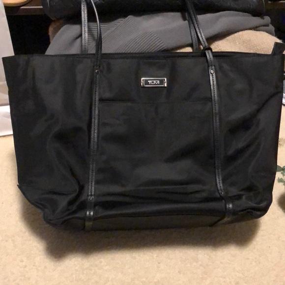Tumi black nylon Voyageur bag with leather straps.  M 5a73821aa825a647dfb3de8a d57d7532e3